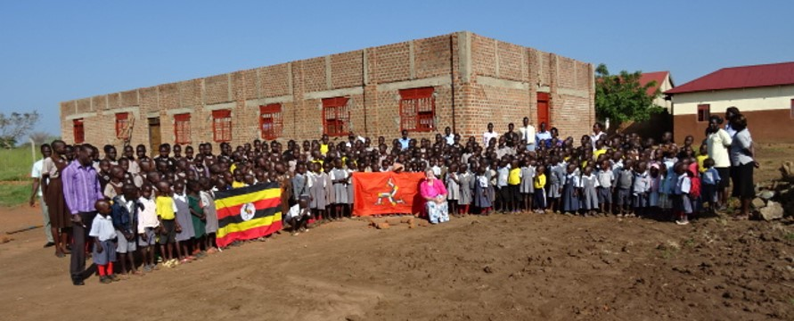 Broadway Primary School pupils with new hall building