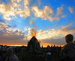 Crowd watching a bonfire on Midsummer Eve