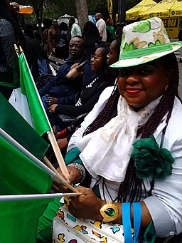Woman with Nigerian flags